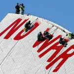 Workers remove anti-war graffiti from the Sydney Opera House in 2003. Photo: Rick Stevens